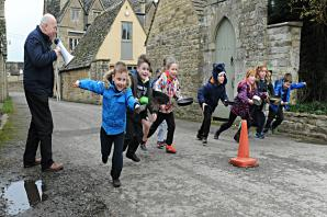 Residents brave the cold for pancake race in South Cerney